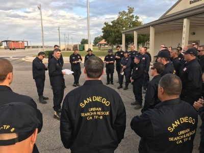 San Diego task force members at a morning briefing in Florida