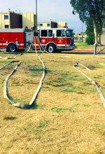 Cadets train with hoses at the fire academy